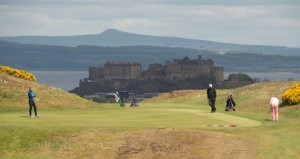 Roddy Forgie looks on as Tim Packenham putts for a birdie in the 2015 Dispatch Trophy, against a backdrop of Edinburgh Castle